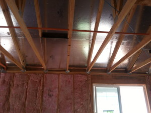 Picture of Radiant barrier installed on the bottom of the sheathing. One of the various ways radiant barrier can be installed in a home.